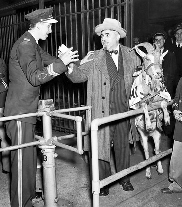 Olaf Logan, Frain usher, stops William Sianis, owner of the Billy Goat Tavern at 1855 W. Madison Street from entering the ball park October 12, 1945. Sianis crashed the gate but could not seat the goat in the box. Sianis is going to sue. Tribune file photo. (baseball World Series, Chicago Cubs, Detroit Tigers)